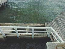Wooden pier on cloudy day. Broken wooden pier on cloudy day. Background royalty free stock photo