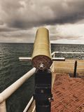 Wooden pier on cloudy day royalty free stock photography