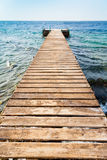 Wooden pier on coast of Coral beach Royalty Free Stock Image