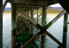 Wooden pier construction from below royalty free stock images