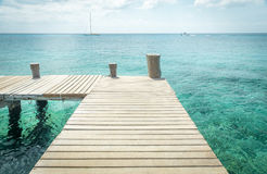Wooden pier on Cozumel Island in Mexico Stock Images