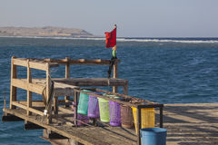 Wooden pier for diving and snorkeling royalty free stock images