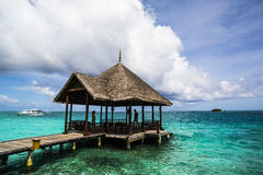 Wooden pier and dock, Indian Ocean, Maldives Stock Images
