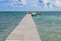 Wooden pier dock and ocean view at Caye Caulker Belize Caribbean royalty free stock photography
