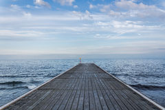 Wooden pier at dusk Stock Photos