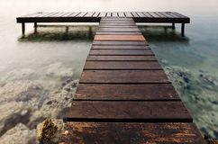 Wooden pier in the early hours of the morning Stock Photos