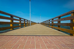 Wooden pier on the embankment of the Baltic Sea. In the Kaliningrad Region Stock Photography