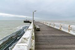Wooden pier entrance of North Sea port in Nieuwpoort. Wooden pier at the entrance of North Sea port in Nieuwpoort, Belgium Royalty Free Stock Images