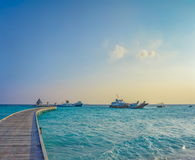 Wooden pier with evening sky and sea background in Maldives Royalty Free Stock Photos