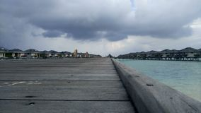 Wooden pier and exotic bungalow. stock video footage