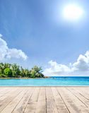 Wooden pier, exotic sea and the blue sky. Wooden pier, exotic sea and a blue sky. Beautiful summer background. Vacation and traveling concept stock image
