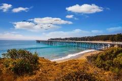 Wooden pier far out to sea Stock Photos