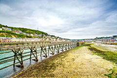 Wooden Pier in Fecamp village harbor. Normandy France. Stock Photo