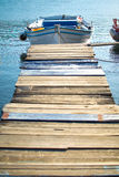 Wooden pier and fishing boat Stock Photography