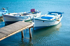 Wooden pier and fishing boats Stock Images