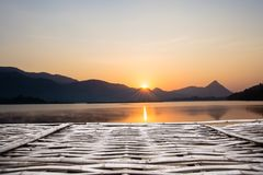 Wooden pier in front of sunset background. wood floor over sea and sky,. Can used for background or wallpaper. beach & summer concepts stock photos