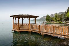 Wooden pier and gazebo on a lake Royalty Free Stock Photo
