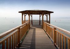 Wooden pier and gazebo on a lake Royalty Free Stock Image