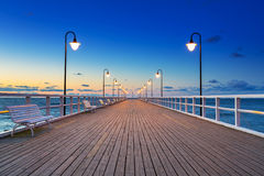 Wooden pier in Gdynia Orlowo at sunrise Stock Images