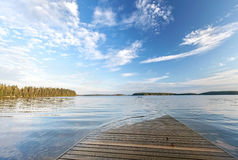 Wooden pier goes under water Royalty Free Stock Images