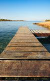 Wooden pier in Greece extending into the sea Royalty Free Stock Images