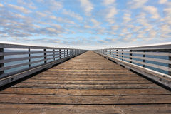 Wooden pier with handrails Stock Photography