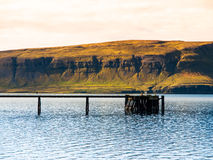 Wooden pier in the icelandic fjord Royalty Free Stock Photography
