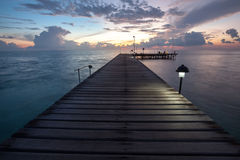 Wooden pier at the island in Indian ocean Royalty Free Stock Photography