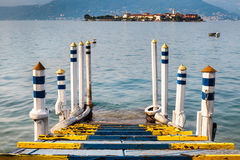 Wooden pier with island view Royalty Free Stock Photos