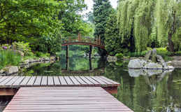 Wooden pier in a japanese garden Royalty Free Stock Photos