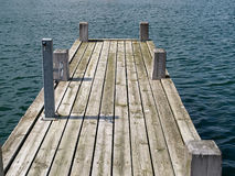 Wooden pier jetty in a marina Stock Image