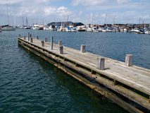Wooden pier jetty in a marina Royalty Free Stock Image
