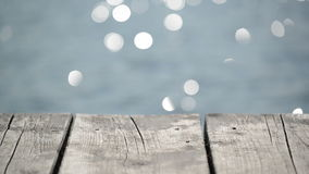 Wooden Pier Jetty on River with Water Sparkling Bokeh stock video footage