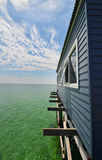 Wooden pier or jetty, sea and cloudscape at Busselton Australia. Point of view perspective - blue pier or jetty over turquoise sea and blue sky background Stock Image