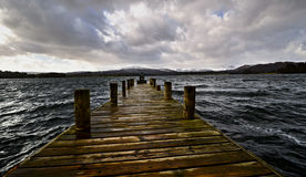 Wooden pier or jetty in stormy water Royalty Free Stock Photos