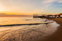 Wooden pier or Jetty at sunset Hua Hin, Thailand. Royalty Free Stock Images