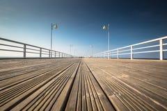 Wooden pier in Jurata town on coast of Baltic Sea, Hel peninsula. Poland Royalty Free Stock Image