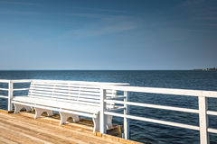 Wooden pier in Jurata town on coast of Baltic Sea, Hel peninsula. Poland Royalty Free Stock Photography