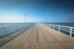 Wooden pier in Jurata town on coast of Baltic Sea, Hel peninsula. Poland Stock Images