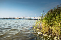 Wooden pier in Jurata town on coast of Baltic Sea, Hel peninsula. Poland Royalty Free Stock Images