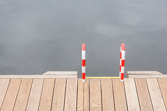 Wooden pier and ladder by the water Stock Photos