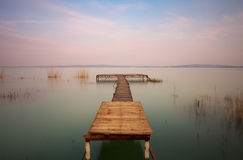 Wooden pier on the lake Stock Images
