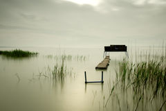 Wooden pier on the lake Royalty Free Stock Photography