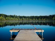 Wooden pier in lake Stock Photo