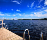 Wooden pier on a lake. Beautiful nature background Royalty Free Stock Photography