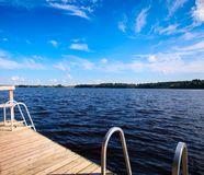 Wooden pier on a lake. Beautiful nature background Stock Image