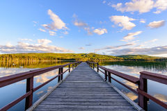 Wooden pier on the lake Stock Photos