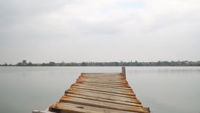 Wooden pier on lake, zooming stock video