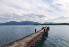 Wooden pier on lake. Chiemsee in Bavaria, Germany Stock Photography