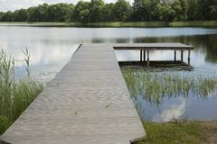 Wooden pier in lake Stock Images